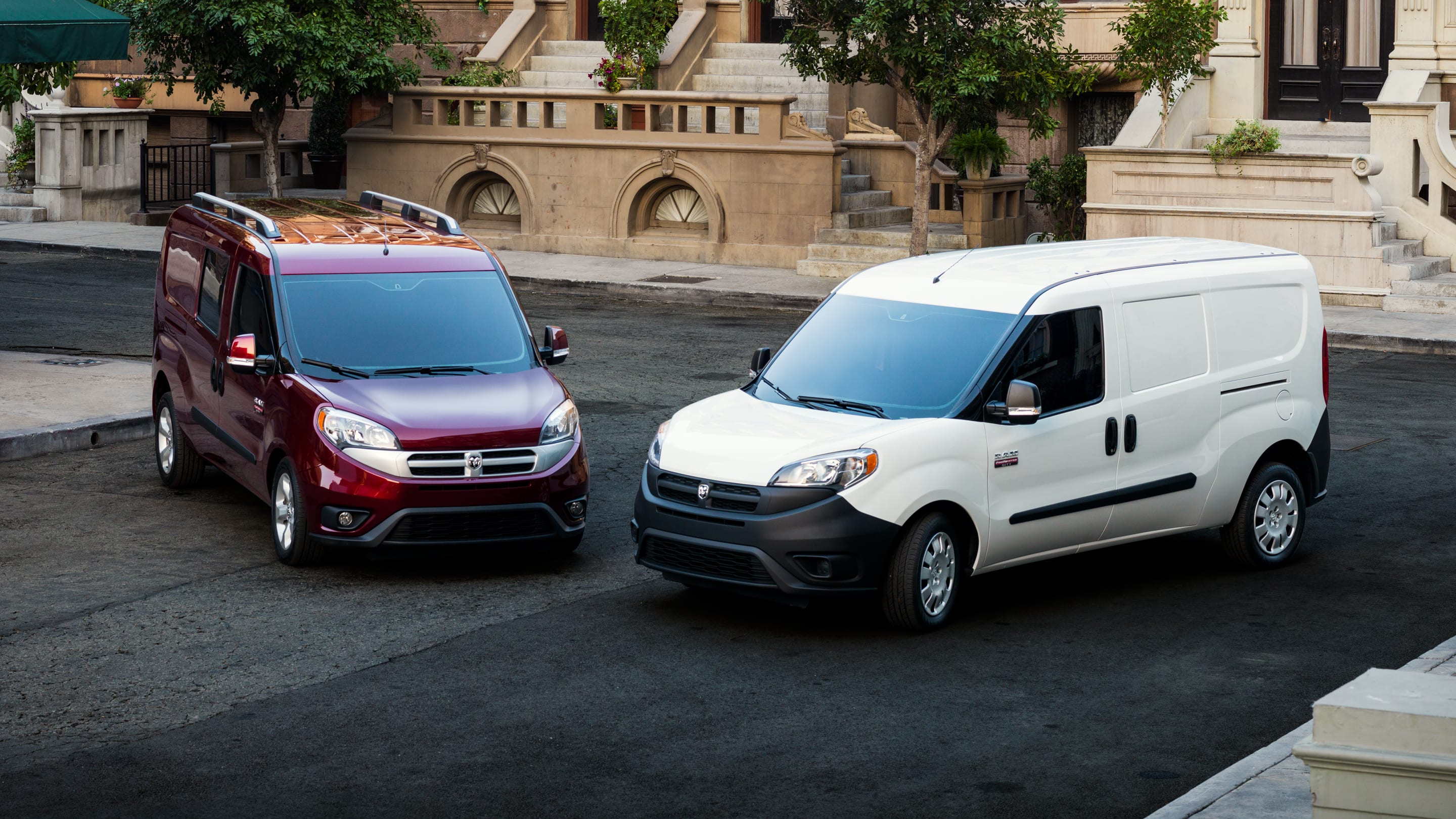 Display Ram ProMaster City Wagon and Cargo vans parked side by side.