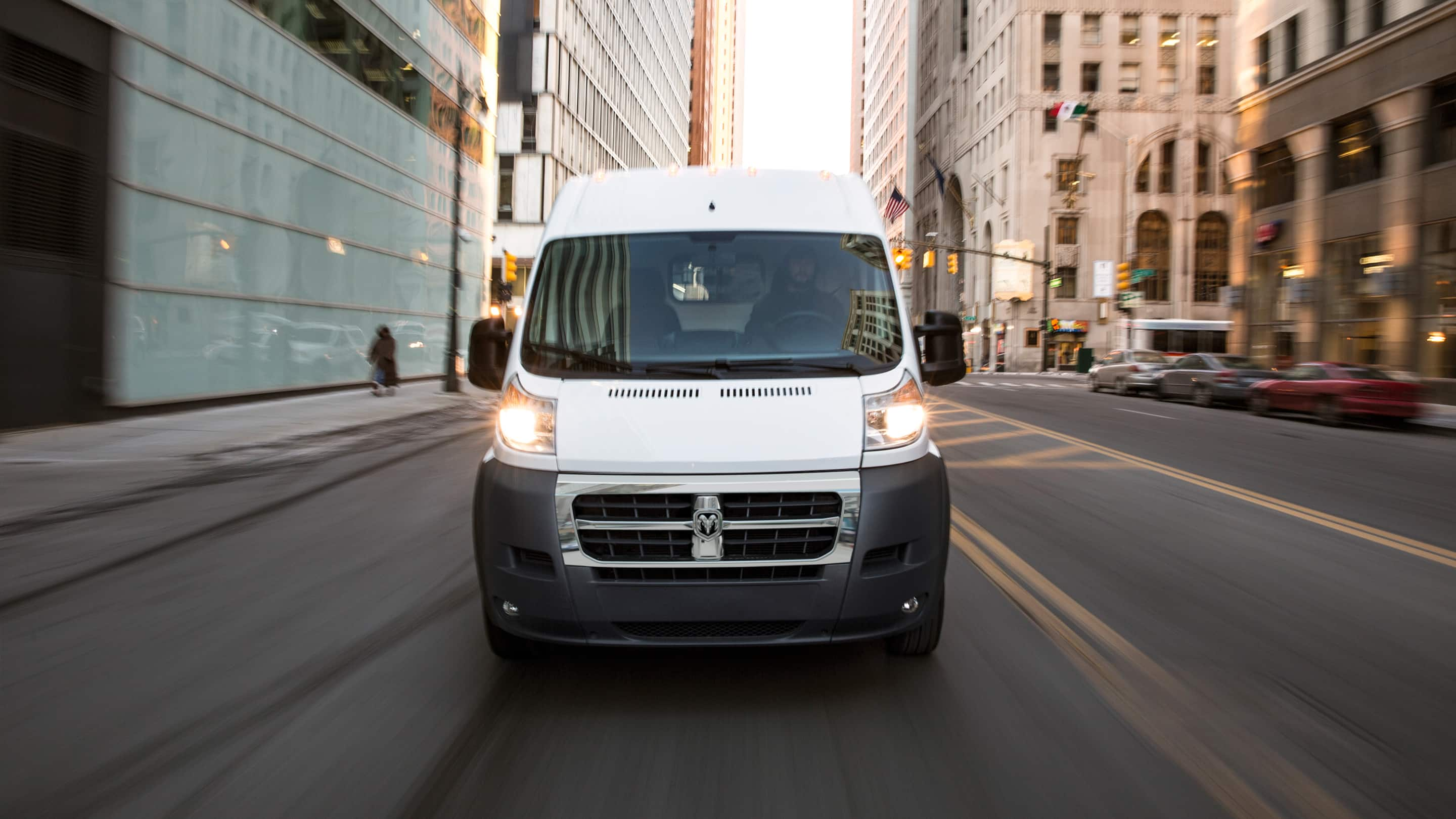 Display Ram ProMaster driving in a city.
