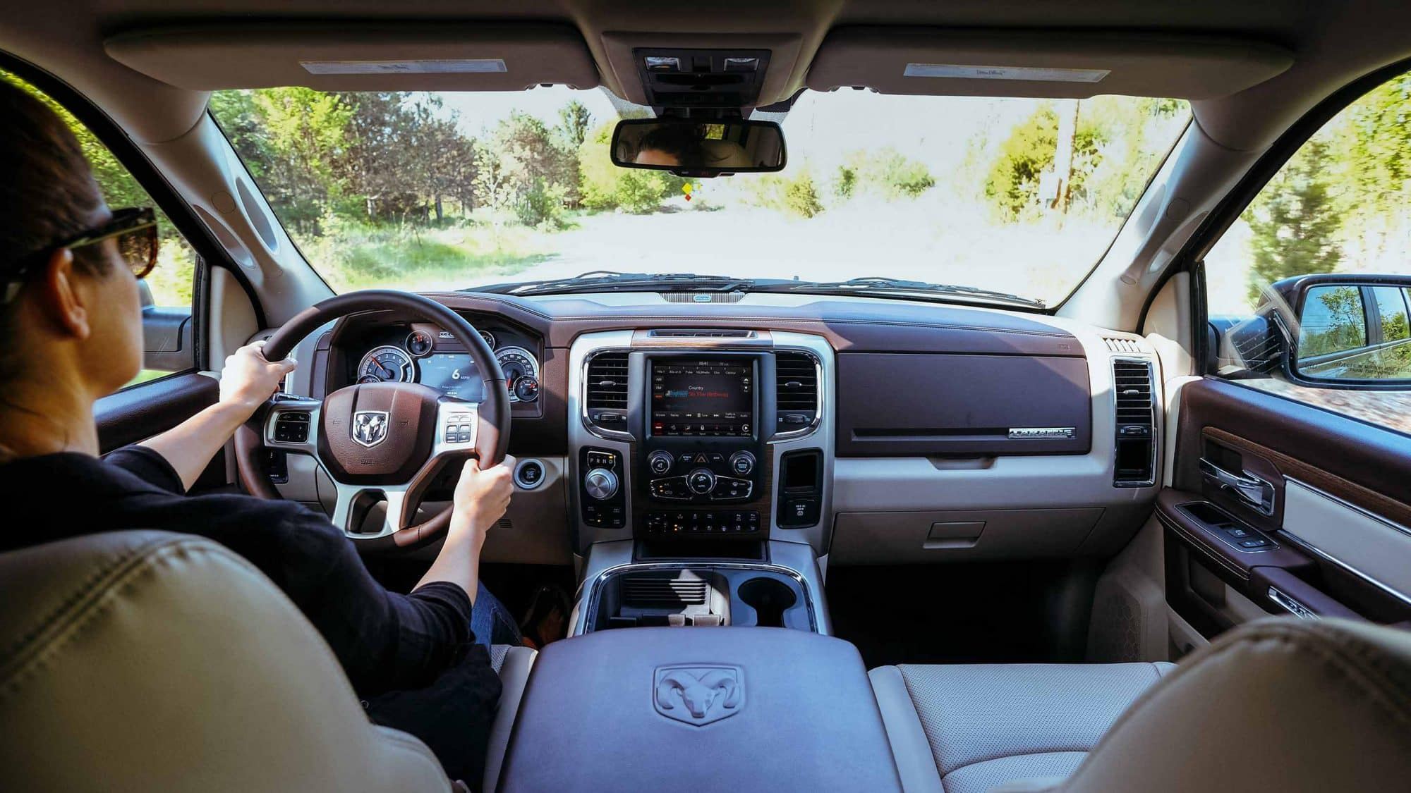 View from back seats of driver inside 2018 RAM 1500