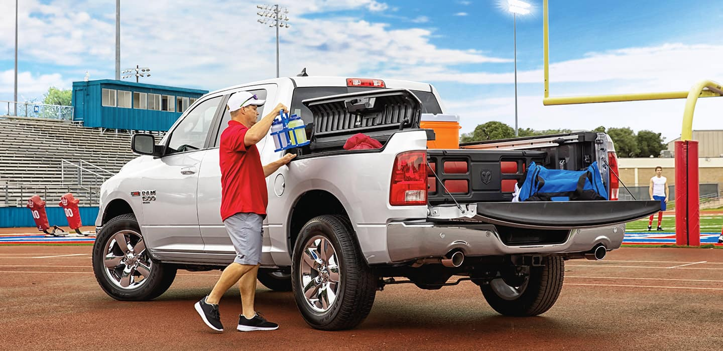 Display Man loading cargo in the RamBox Cargo Management system on his Ram 1500 Classic.