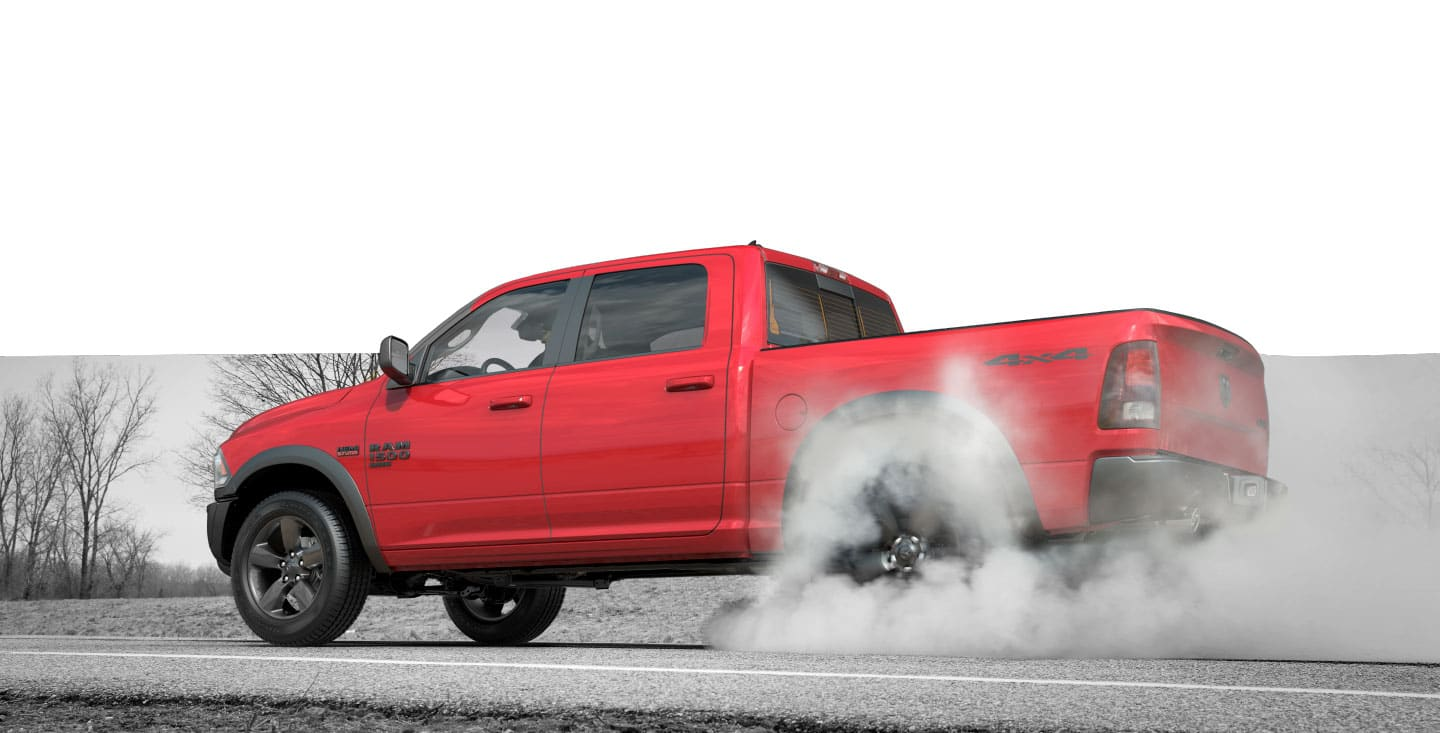 Ram 1500 Classic Warlock burning rubber on a paved road.