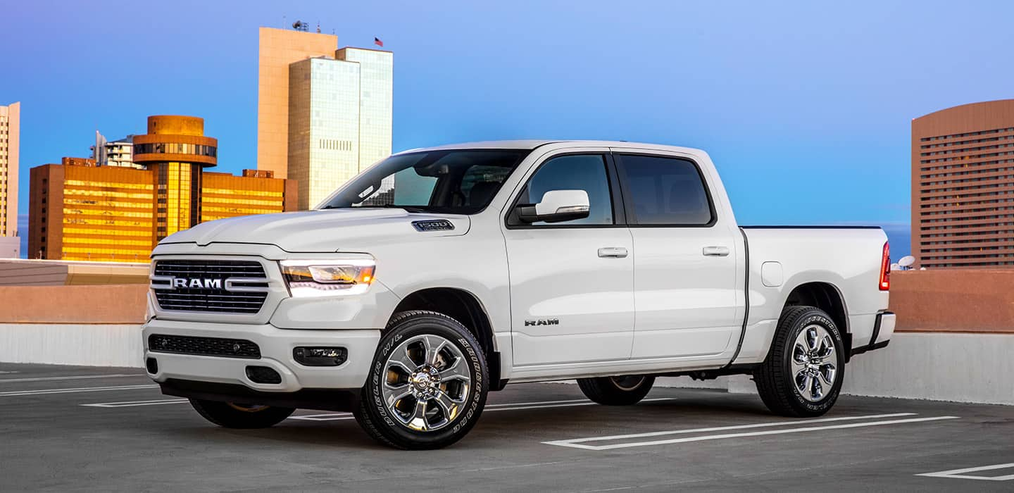 The All-New Ram 1500 Big Horn/Lone Star with the available Sport Appearance Package parked on a rooftop garage in the city.