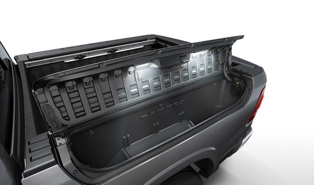 RamBox cargo management system open on black 2019 Ram 1500