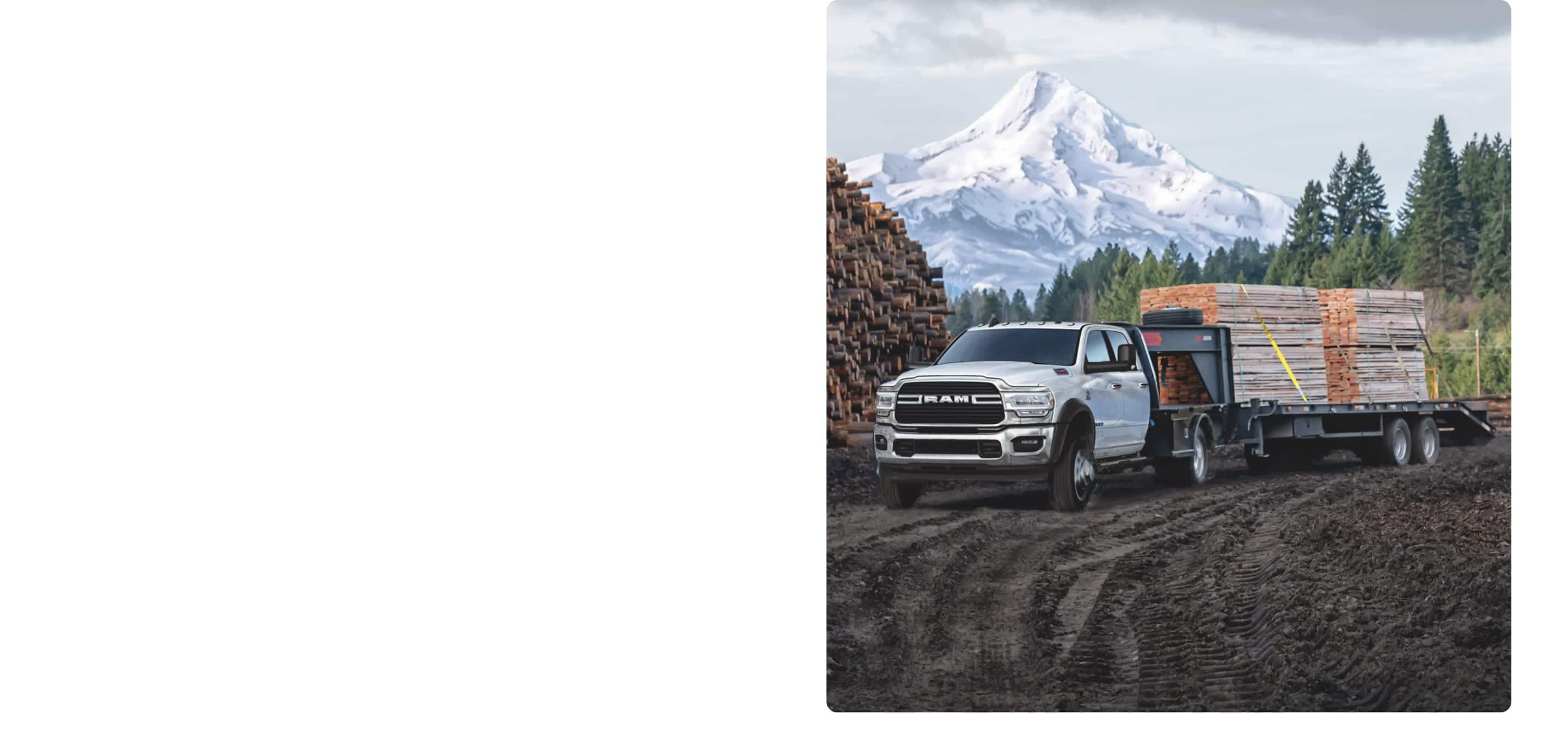 The 2020 Ram Chassis Cab carrying lumber as it traverses a dirt track.