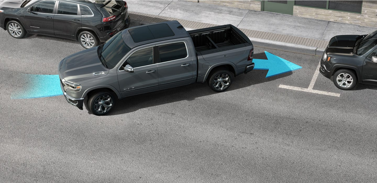 A 2020 Ram 1500 backing into a parking spot with a blue arrow illustrating how the vehicle assists the driver when parking.