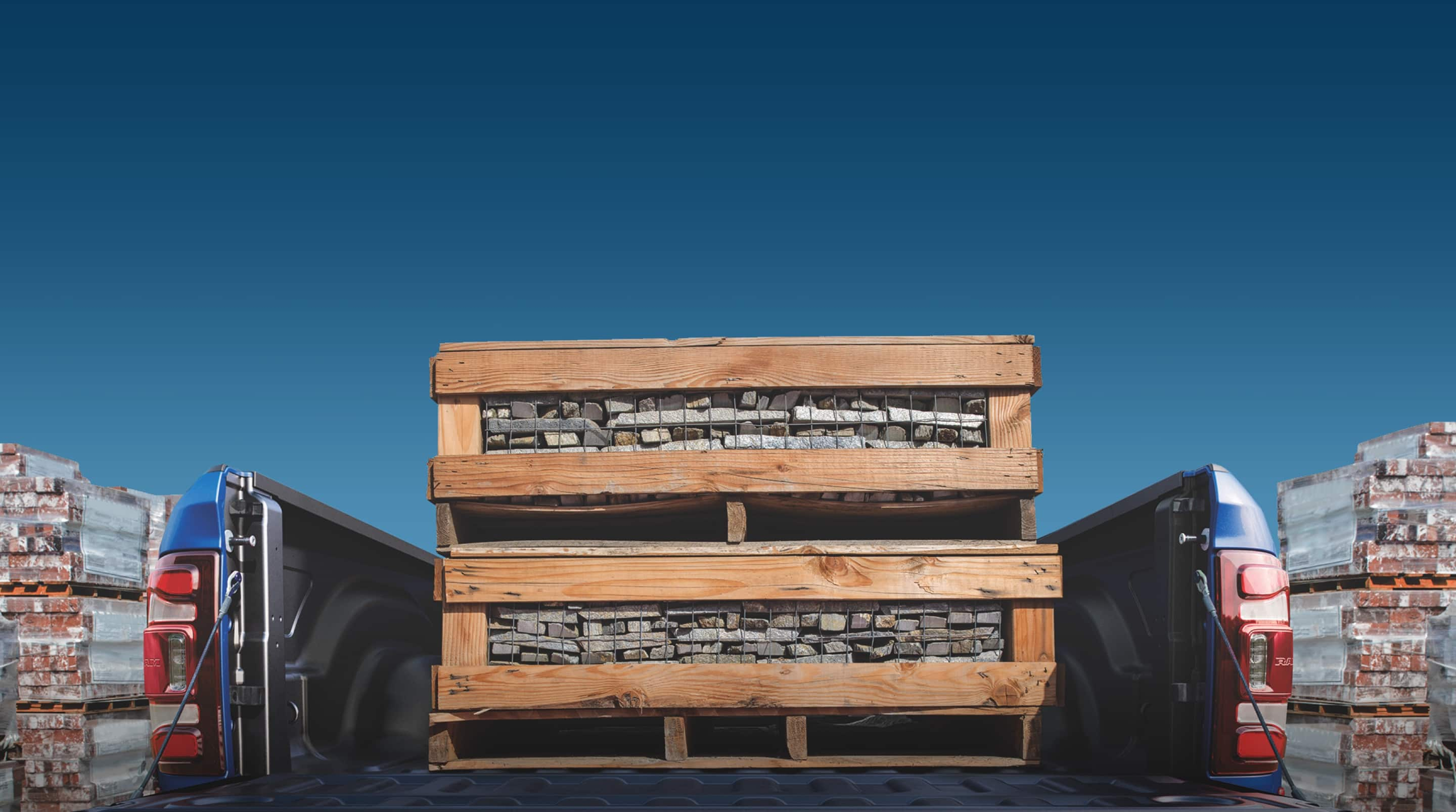 The bed of a 2020 Ram 2500 piled high with pallets of bricks.