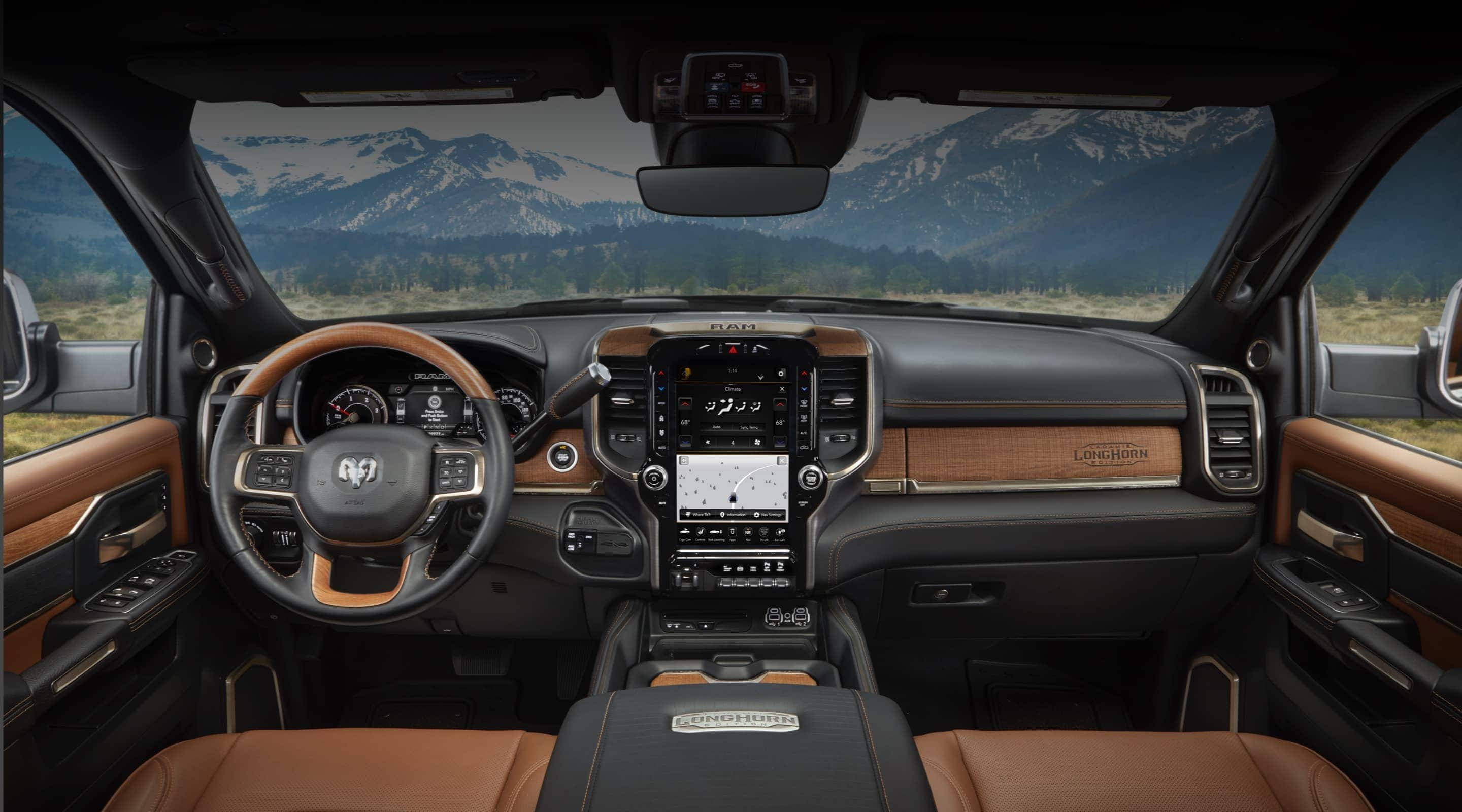 The interior of the 2020 Ram 3500 Laramie Longhorn with leather and wood accents.