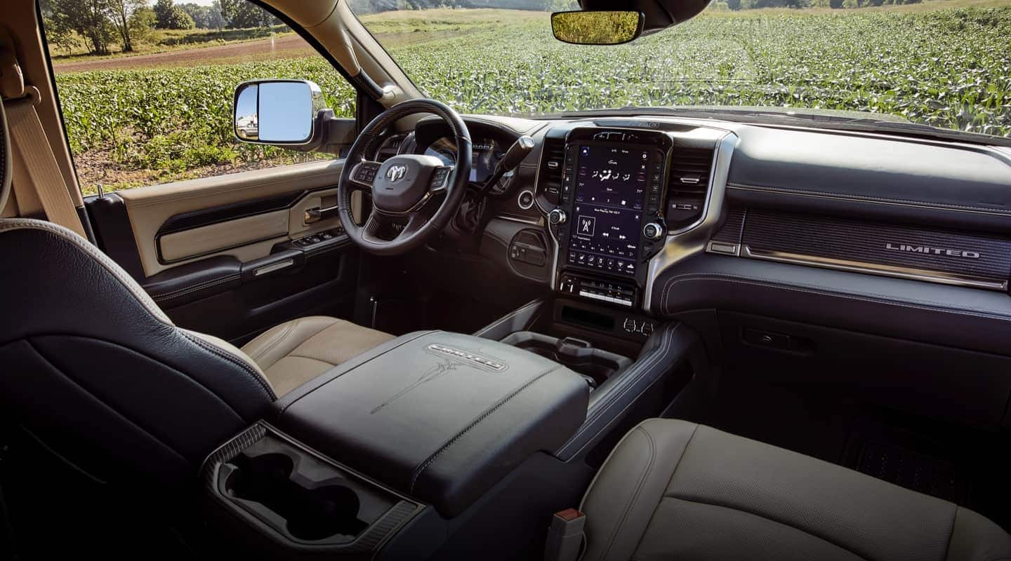 The interior of the 2020 Ram Chassis Cab showing the steering wheel, dashboard and entertainment center.