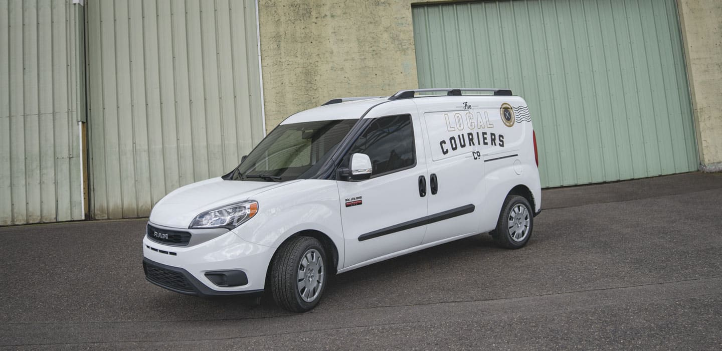 Display A 2020 Ram ProMaster City Cargo Van bearing the logo of a courier company.