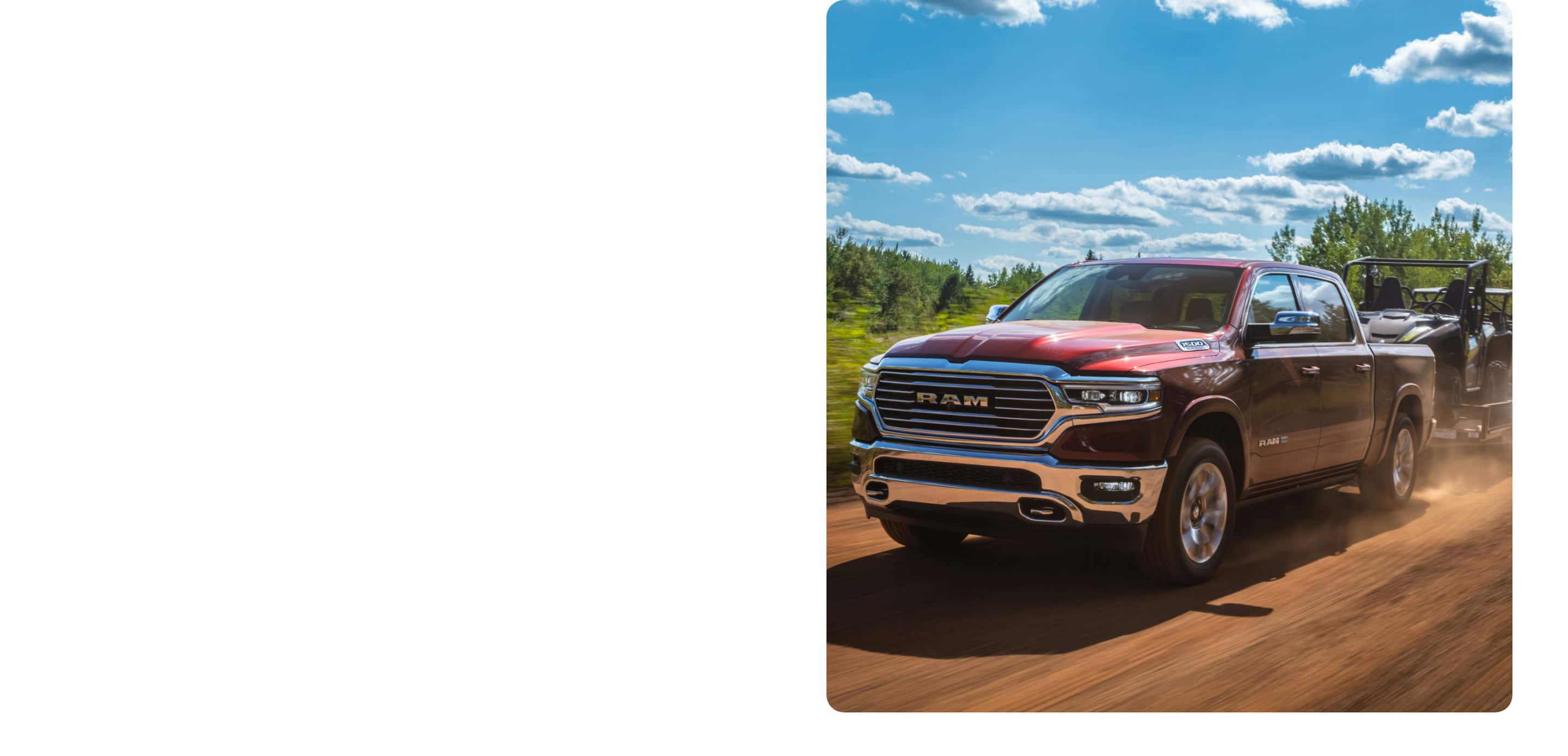 The 2021 Ram 1500 towing farm equipment on a dirt road.