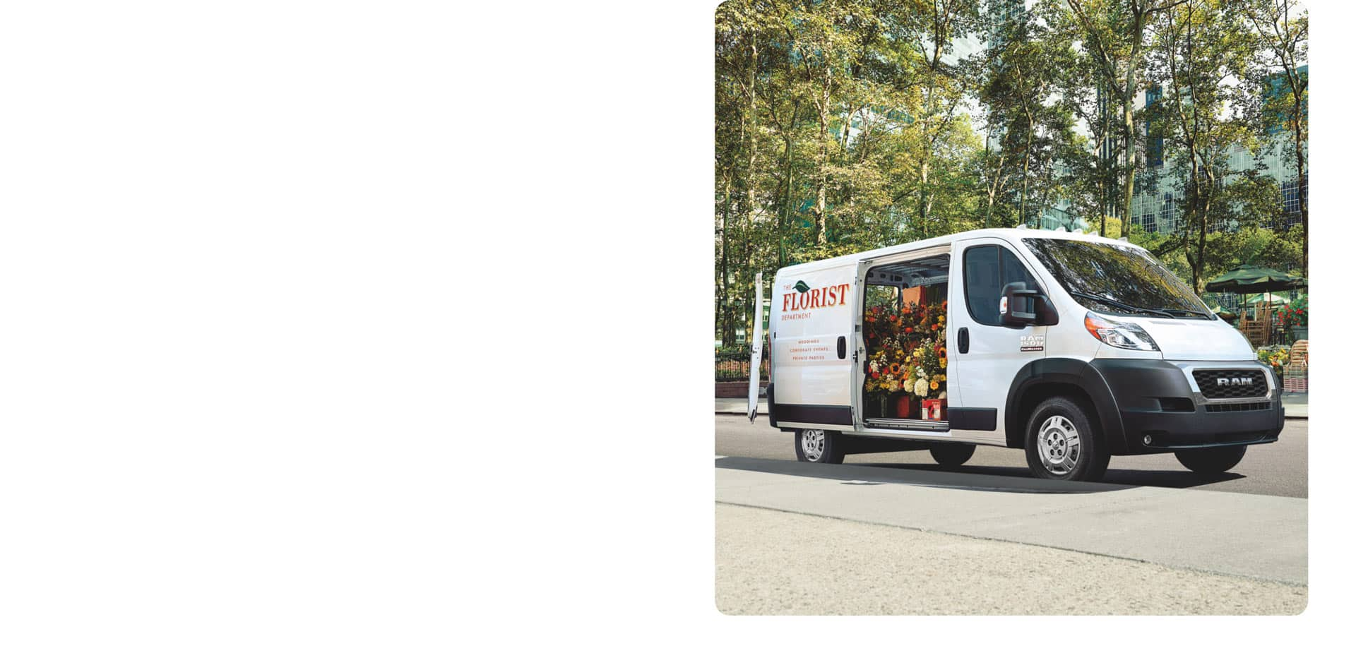 A 2021 Ram ProMaster with the logo of a florist on its side, its doors open to reveal the interior filled with flowers.