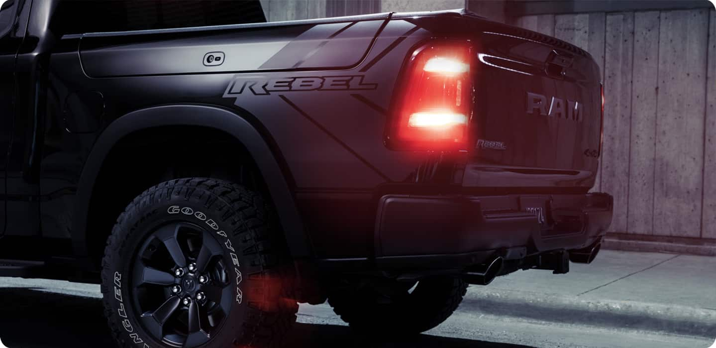 A close-up of the taillamp and Rebel badging on a red 2021 Ram 1500 Rebel.
