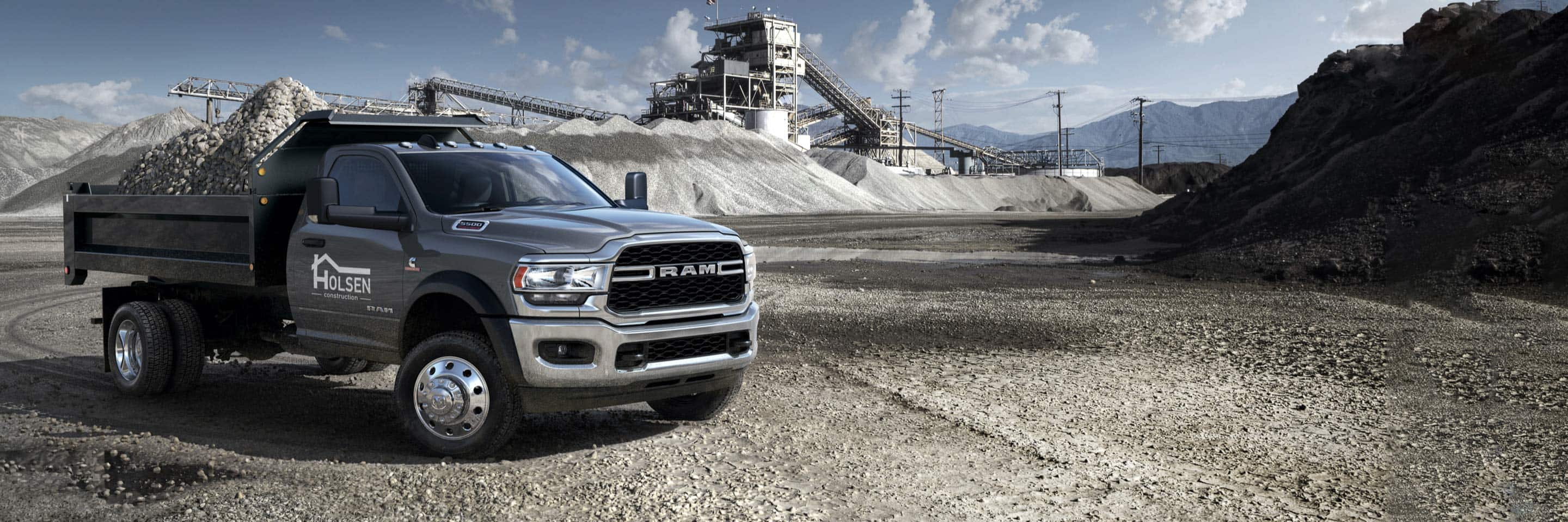The 2021 Ram Chassis Cab with a dump truck upfit loaded with gravel.