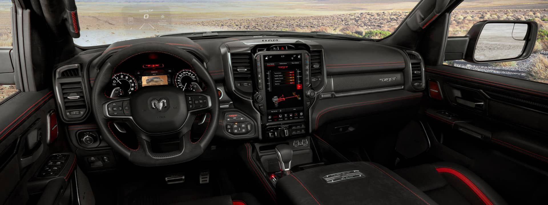 Interior shot from the perspective of the driver seat in the 2021 Ram 1500 TRX showcasing premium interior materials and technology.