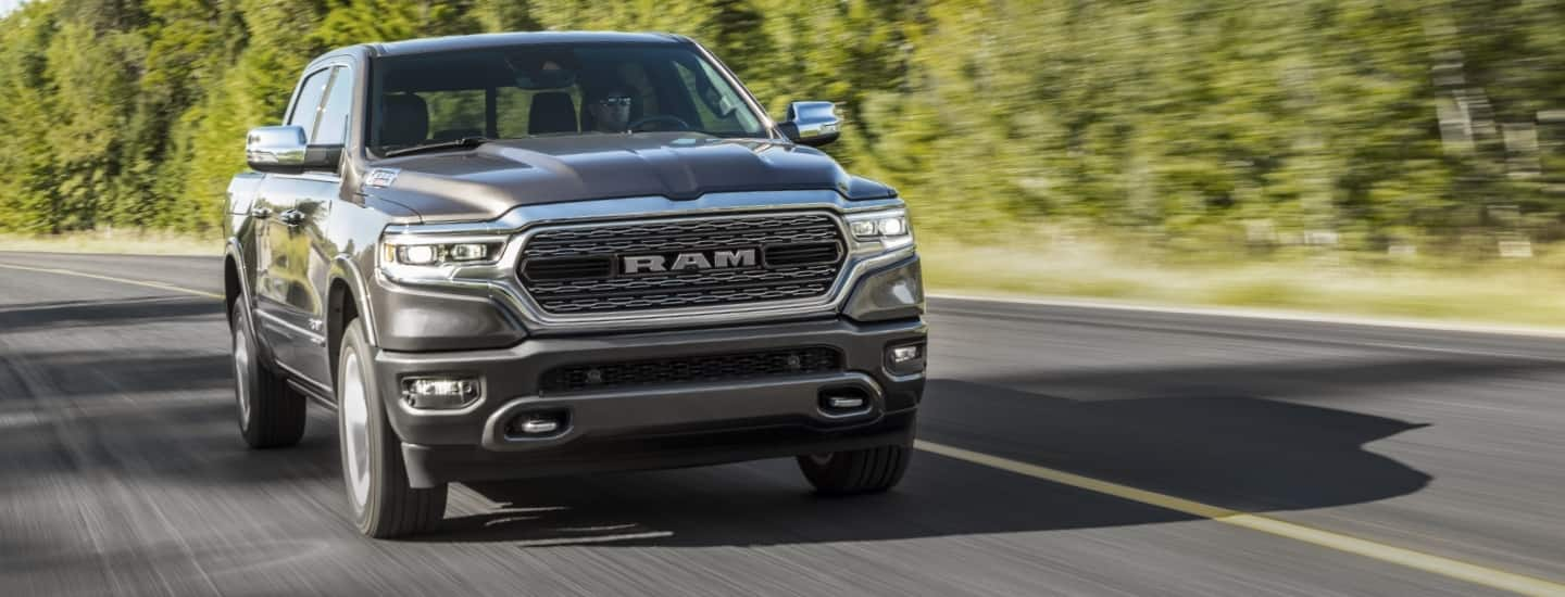 A head-on view of a 2020 Ram 1500 being driven on a two-lane road