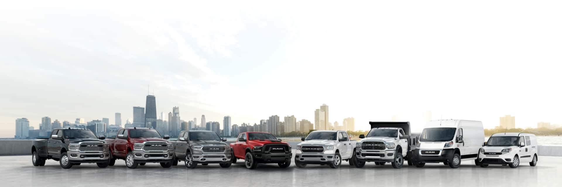 A lineup of 2020 Ram trucks and vans.