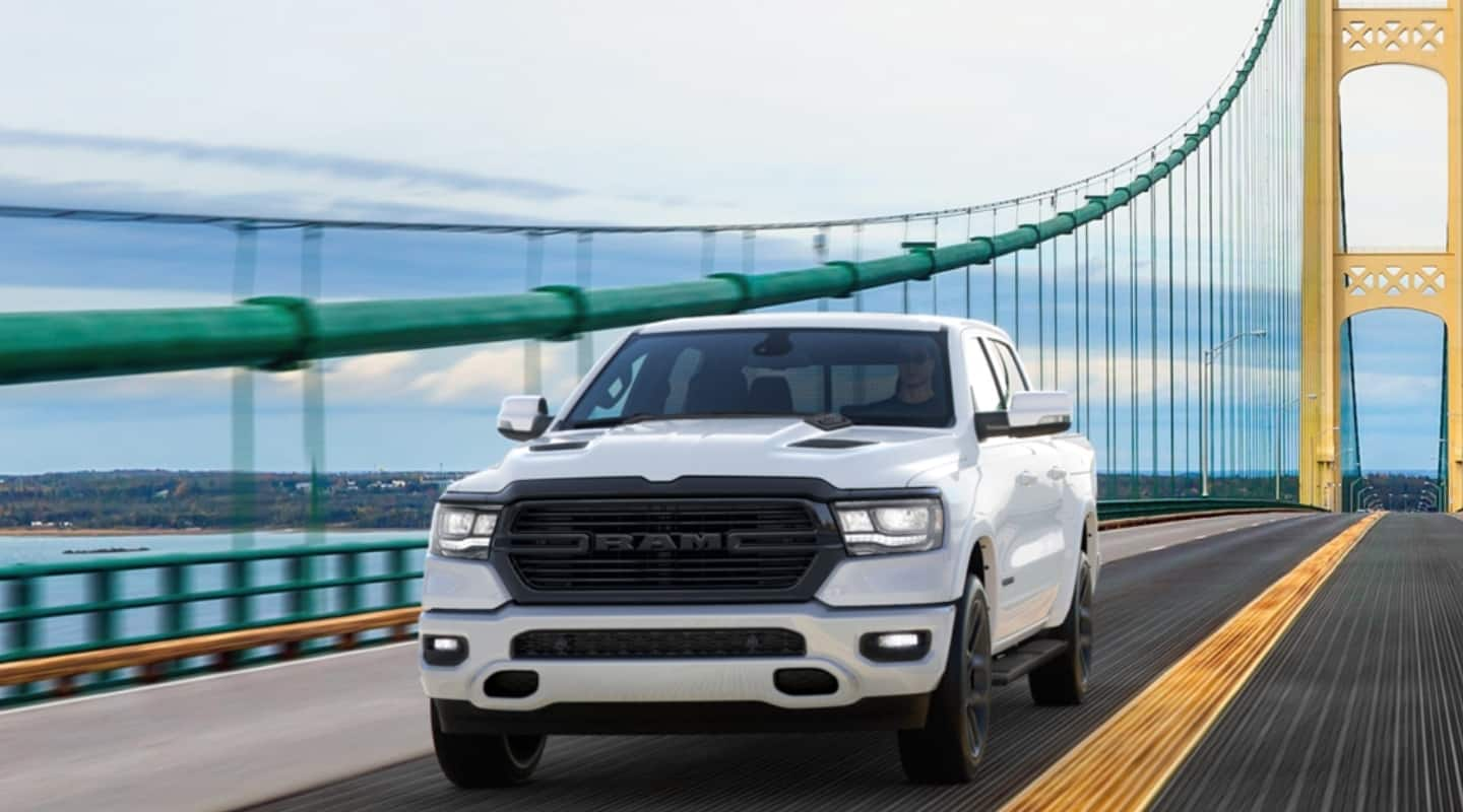 The 2020 Ram 1500 Big Horn with Night Edition Package is being driven over a suspension bridge.