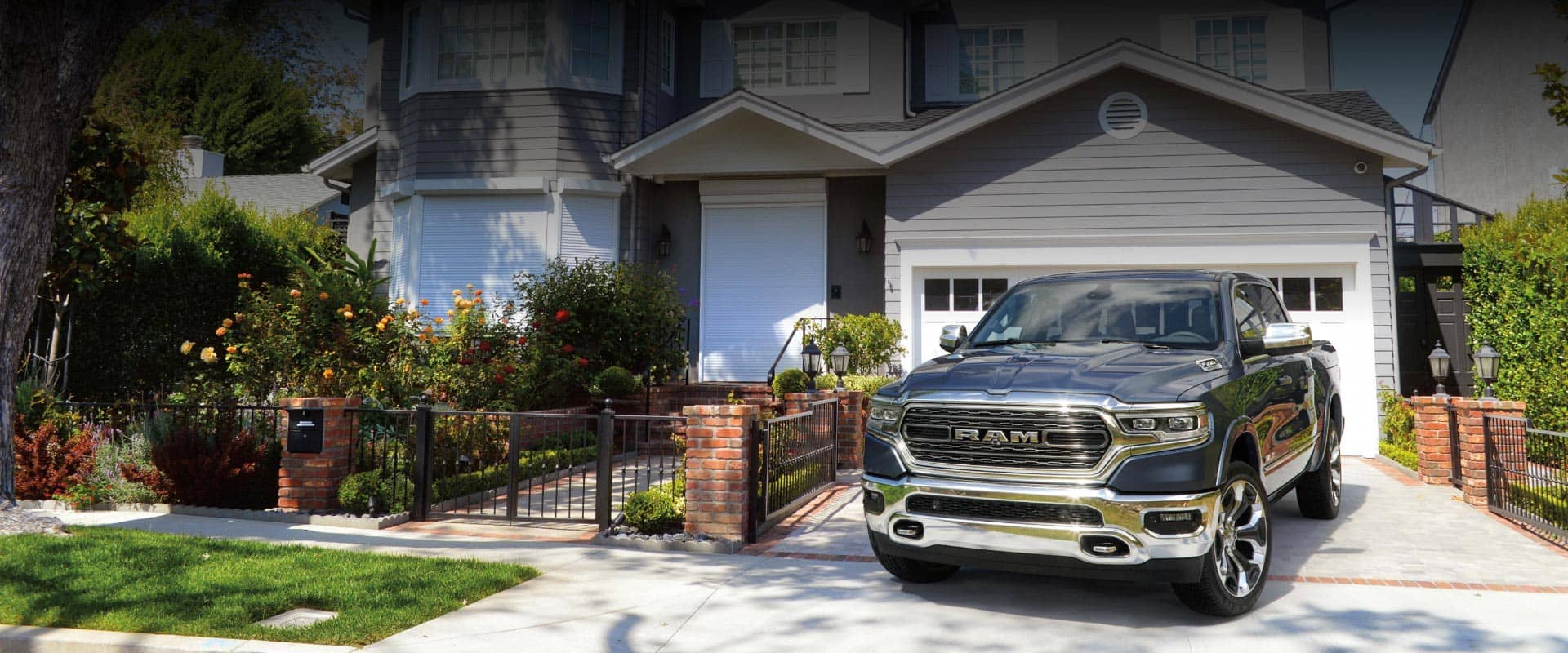 2020 Ram 1500 Limited parked in the driveway of a suburban home.