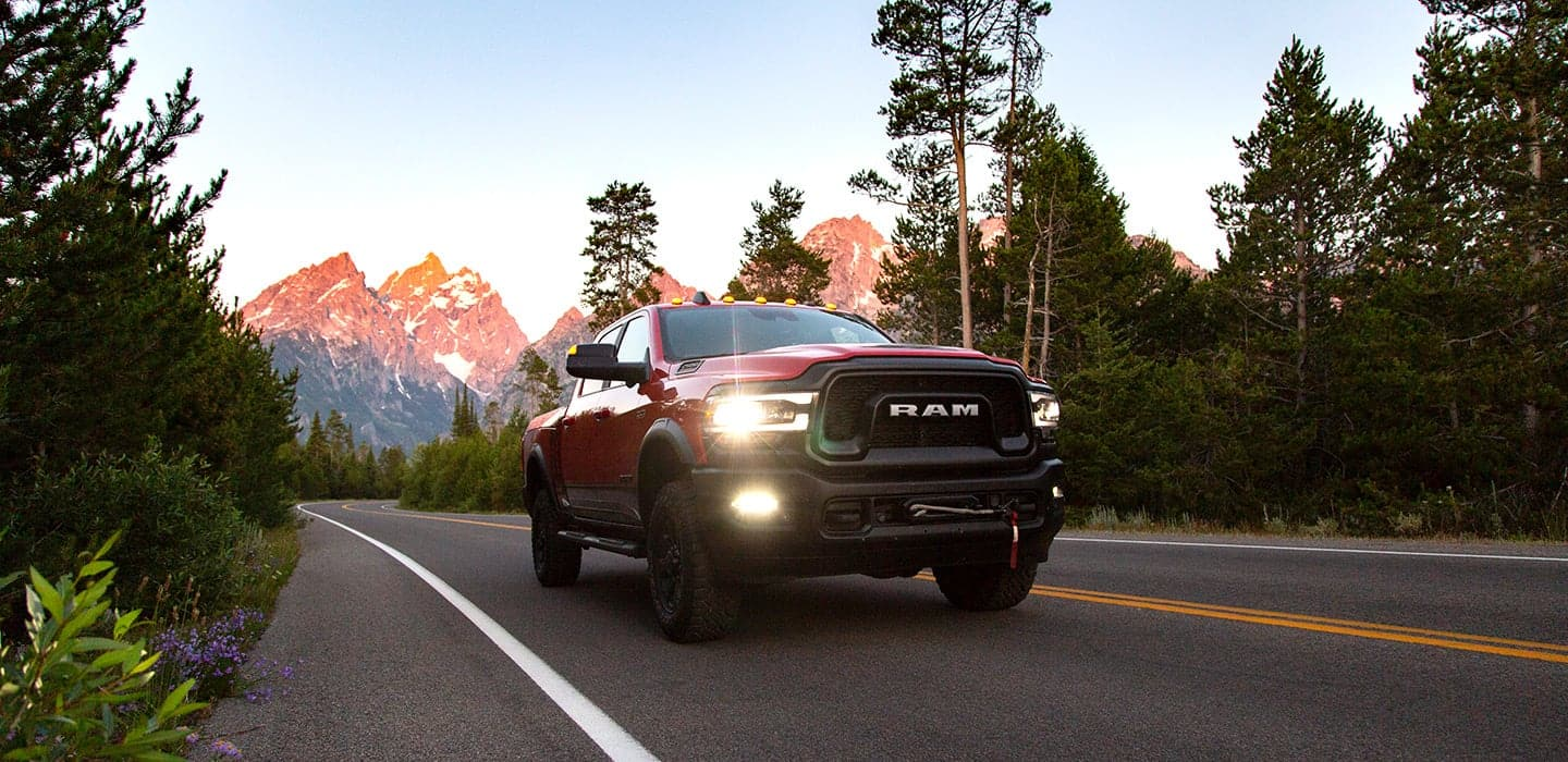 Display 2019 Ram 2500 Power Wagon driving on a mountain road.