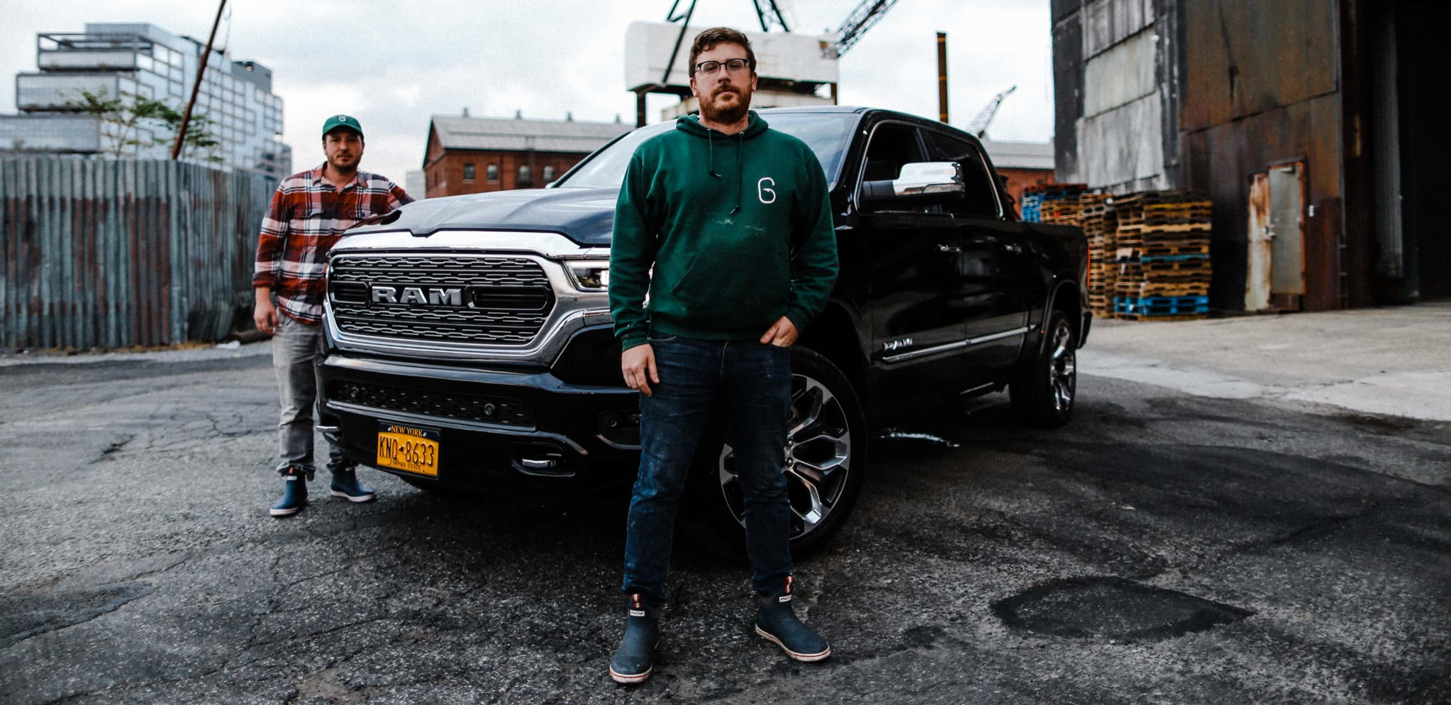 Display A man stands proudly in front of his 2019 Ram 1500 Limited.