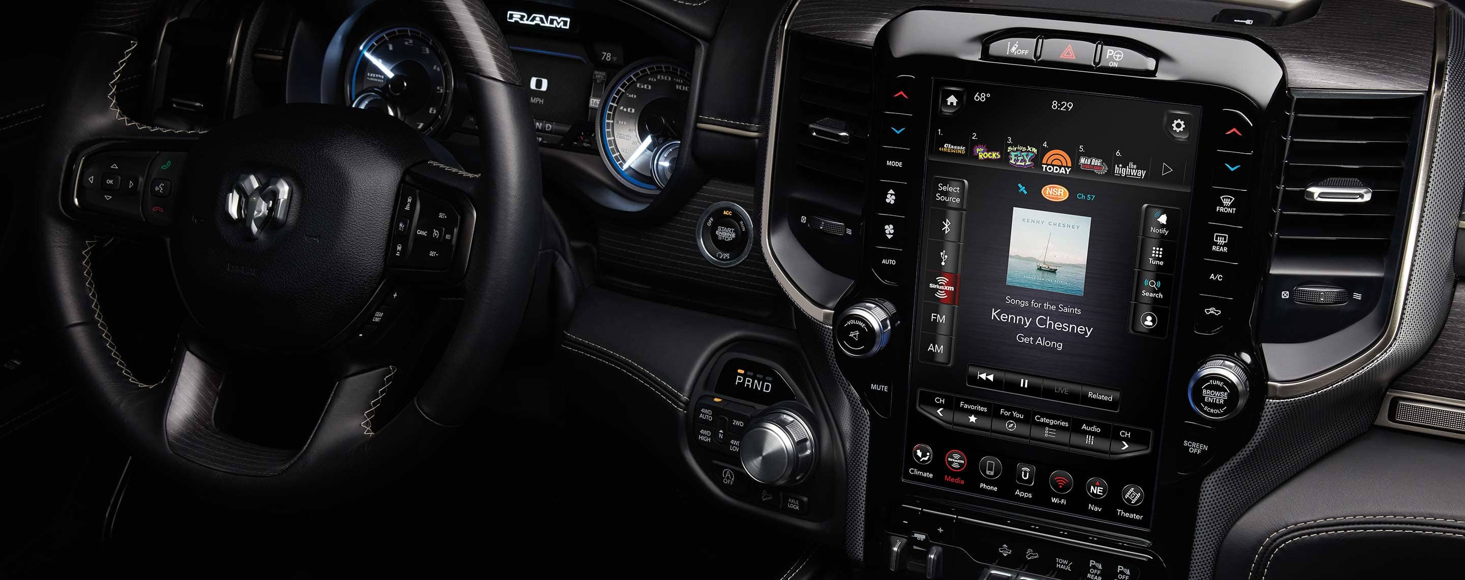 The interior of the 2021 Ram 1500, focusing on the 12-inch touchscreen displaying song title and artist info for the music playing.