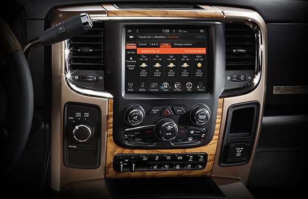 The 2013 Ram 1500 truck Uconnect® mobile entertainment dashboard with Bluetooth and Sirius Radio